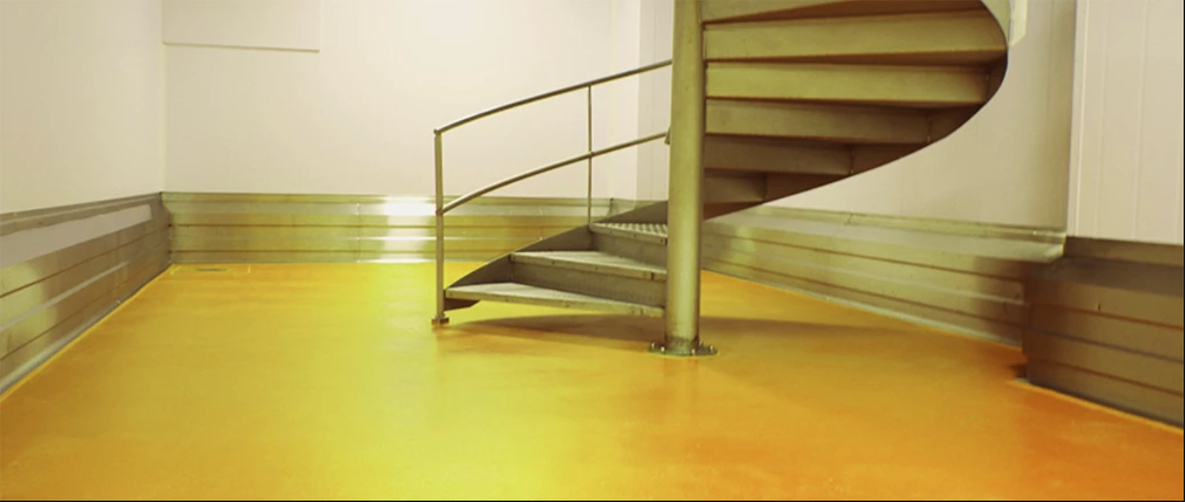 yellow floor with spiral stairs